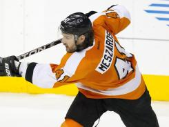Philadelphia Flyers defenseman Andrej Meszaros (41) shoots the puck against the New York Islanders on Thursday night. The Flyers defeated the Islanders 6-3 behind two goals from Matt Read.