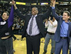 Sacramento Mayor Kevin Johnson, middle, celebrates with the Maloof brothers, owners of the NBA's Kings, about reaching an agreement to keep the club in town.