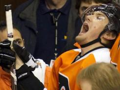 Philadelphia Flyers left wing James van Riemsdyk reacts to getting hurt against the New York Islanders during the first period Thursday.
