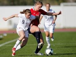Heather O'Reilly (left) fights for the ball with Norway's Elise Thorsnes during the Algarve Cup in Lagos, southern Portugal, on Friday.