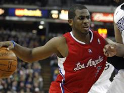 Los Angeles guard Chris Paul tries to dribble past Sacramento forward Chuck Hayes in the second quarter at the Power Balance Pavilion.