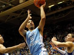 Kendall Marshall (5) had 20 points and 10 assists to help North Carolina clinch its 29th ACC regular season title.