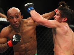 Demetrious Johnson, left, and Ian McCall had a close bout on Saturday in Sydney.