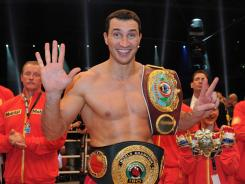 Wladimir Klitschko celebrates after winning his heavyweight title bout against Jean-Marc Mormeck at Esprit Arena in Dusseldorf, Germany. Klitschko recorded the 50th knockout of his career.