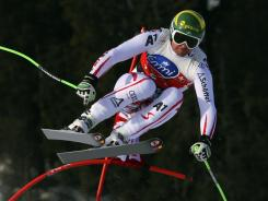 Klaus Kroell goes airborne on his way to winning Saturday's World Cup men's downhill in Kvitfjell, Norway.