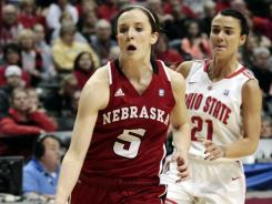 Kaitlyn Burke (5) scored 20 points to help Nebraska reach the title game in its first-ever Big Ten tournament.