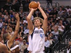 Dirk Nowitzki's season-high 40 points led the Mavericks past the Jazz and snapped a four-game slide.