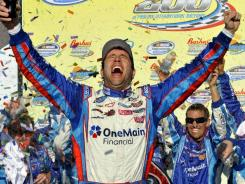 Elliott Sadler celebrates in victory lane after winning his first Nationwide Series race in 14 years at Phoenix International Raceway.