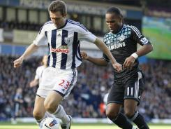 West Bromwich Albion's Gareth McAuley, left, dribbling past Chelsea's Didier Drogba, scored the game-winner in the 82nd minute.