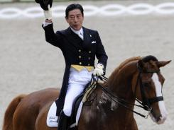 "Hiroshi Hoketsu of Japan on ""Whisper"" competes in the Havens Prize dressage event of the CHIO World Equestrian Festival in Aachen, Germany, on July 3, 2008."