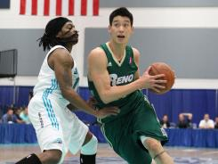 Jeremy Lin drives to the basket for the D-League Reno Bighorns in a January 2011 photo.
