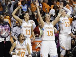 Tennessee players celebrate on the bench in the final moments as the Lady Vols clinch their third consecutive SEC tournament title.