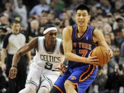 Knicks point guard Jeremy Lin, right, gets pressured by the Celtics' Rajon Rondo during the fourth quarter. Lin had 14 points but also six turnovers while Rondo had a triple-double in Boston's overtime win vs. New York.