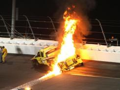 A jet drier catches fire after NASCAR Sprint Cup Series driver Juan Pablo Montoya lost control of his car and collided with it in Turn 3 during the Daytona 500.