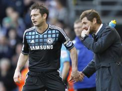 Chelsea's manager Andre Villas-Boas (right) talks to Frank Lampard during an English Premier League match between West Bromwich Albion and Chelsea at The Hawthorns in West Bromwich, England on Saturday.