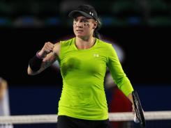 Bethanie Mattek-Sands of the USA, with her one-sleeve, lime-green get-up at the Australian Open.