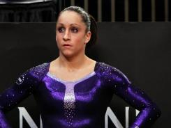 Gymnast and current all-around world champion Jordyn Wieber stands on the sidelines of the vault competition during the 2012 AT&T American Cup at Madison Square Garden.