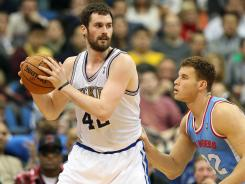 Kevin Love (42) scored 39 points to lead the Timberwolves to their third win of the season over Blake Griffin and the Clippers.