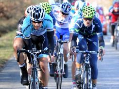 Belgium's Tom Boonen (left) and Spain's Alejandro Valverde ride in the pack on Monday during the 185.5-kilometer second stage between Paris-Mantes-la-Jolie and Orleans during the 70th edition of the Paris-Nice cycling race. Belgium's Tom Boonen won the stage and Britain's Bradley Wiggins took the overall lead.