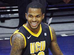 Virginia Commonwealth's Troy Daniels (30) can't hide his elation after winning the CAA championship over Drexel at the Ricmond Coliseum in Richmond, Va.