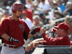 "Diamondbackmanager Kirk Gibson, right, said he'd ""prefer not to be miked up, but hell, I'll do my part."""
