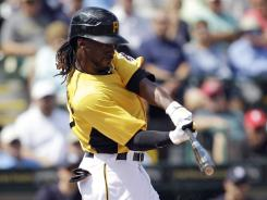 Pirates' Andrew McCutchen, fresh off a new contract, hits an RBI-single off Yankees pitcher CC Sabathia.