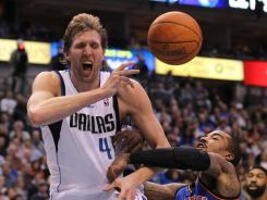 Dallas forward Dirk Nowitzki (41) is fouled by New York guard J.R. Smith in the third quarter at American Airlines Center.