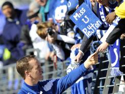 Indianapolis Colts quarterback Peyton Manning signs autographs for fans before a game against the Baltimore Ravens in Baltimore on Dec. 11, 2011.