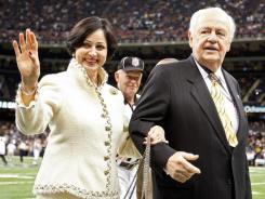 New Orleans Saints owner Tom Benson and his wife Gayle walk on the field prior to the 2012 NFC Wild Card Playoff game between the New Orleans Saints and the Detroit Lions.
