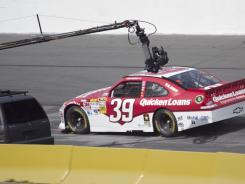 A camera follows Ryan Newman's No. 39 Chevrolet during a commercial shoot in February.