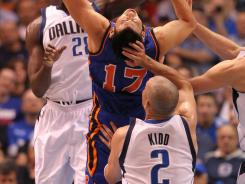 Dallas Mavericks guard Jason Kidd, No. 2, seems to grab a handful of hair trying to defend New York Knicks guard Jeremy Lin in Dallas' win Tuesday.