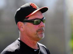 Manager Bruce Bochy takes the field during Giants camp.