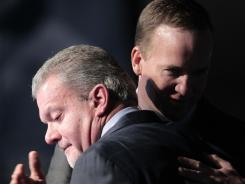 Indianapolis Colts owner Jim Irsay, left, hugs quarterback Peyton Manning after announcing that the team will release Manning.