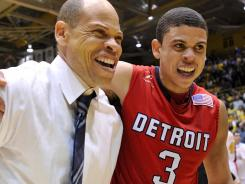 Detroit coach Ray McCallum and guard Ray McCallum celebrate their Horizon League Championship at the Athletics-Recreation Center.