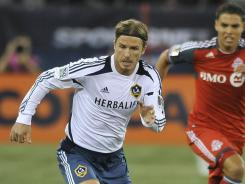 Galaxy midfielder David Beckham runs with the ball during a CONCACAF Champions League match against Toronto FC at the Rogers Centre in Toronto on Wednesday.