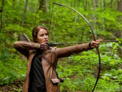 """In this image released by Lionsgate, Jennifer Lawrence portrays Katniss Everdeen in a scene from """"The Hunger Games,"""" set for release on March 23. Lawrence was coached in archery by four-time Olympian Khatuna Lorig."""