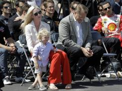 Susie Wheldon, widow of IndyCar driver Dan Wheldon, sits with son Sebastian and St. Petersburg Mayor Bill Foster and other IndyCar drivers on Wednesday in advance of the Izod IndyCar Series opener later this month. Dan Wheldon was killed in a race at Las Vegas Motor Speedway on Oct. 16.
