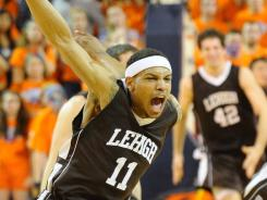 Lehigh guard Mackey McKnight (11) celebrates after defeating Bucknell 82-77 in the Patriot League Conference championship at Sojka Pavilion.