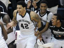 Long Island's bench erupts in celebration after winning the Northeast Conference championship in Brooklyn, N.Y.