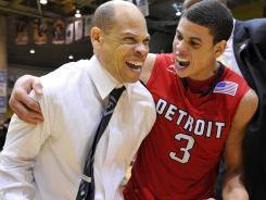 Detroit coach Ray McCallum, left, and his son, guard Ray Jr., celebrate the Titans' Horizon League tournament title and accompanying NCAA tournament berth.