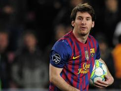 Forward Lionel Messi walks off the field after scoring five goals in Barcelona's 7-1 Champions League victory against Bayer Leverkusen.