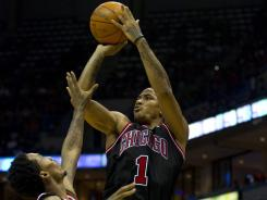 Chicago guard Derrick Rose (1) shoots over Milwaukee guard Brandon Jennings during the second quarter at the Bradley Center.