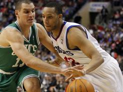Celtics forward Sasha Pavlovic can't reach 76ers guard Evan Turner as the latter drives to the hoop during the second half Wednesday night.