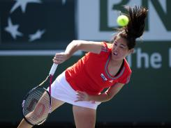 The USA's Jamie Hampton, serving to Polona Hercog of Slovakia, cruised to a 6-1, 6-1 first-round win on Wednesday.