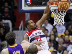 Wizards forward Trevor Booker (35) dunks the ball over Lakers forward Pau Gasol (16) in the second half at Verizon Center.