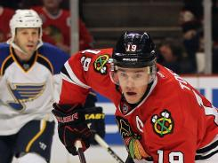 Chicago's Jonathan Toews, right, last played in a Feb. 19 game against the Blues.