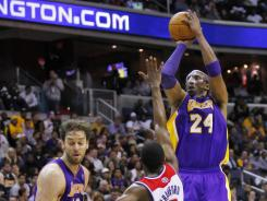 Los Angeles Lakers guard Kobe Bryant, No. 24, shot 9-for-31 in Wednesday's loss at the Washington Wizards, as many shots as the other four starters combined.