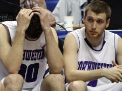 Northwestern forward Davide Curletti, left, and guard Alex Marcotullio react after losing to Minnesota in overtime.