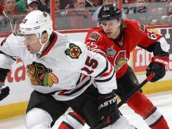 Ottawa's Erik Karlsson, right, is the top-scoring defenseman by far and Senators general manager Bryan Murray says his defense has improved.