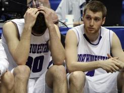 Northwestern forward Davide Curletti, left, and guard Alex Marcotullio react during the final minutes of the team's loss to Minnesota.